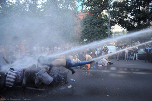 Demonstrators are put under the current of water from a police cannon during #ElectricYerevan, June 23, 2015 / Narek Aleksanyan, Hetq