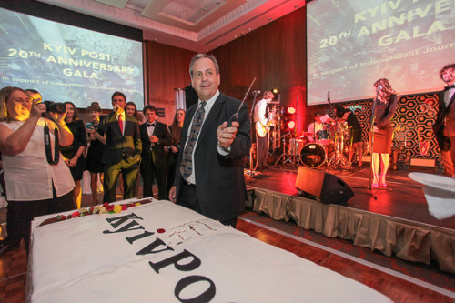 Brian Bonner, chief editor of the Kyiv Post, gets ready to slice up a birthday cake at an event on Sept. 19 marking the 20th year of the publication of the Kyiv Post. Ukraine has made progress over the last decade he has worked in the country, Bonner says, but much still has to be done.